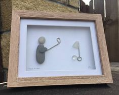 golf hole in one pebble art