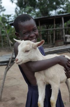 This is Tereza, a distant cousin in Uganda! Meet her family, see how much they love her and how she helped save their lives---> http://www.one.org/us/2013/11/05/lovisas-story-how-1-goat-pulled-a-family-out-of-poverty/