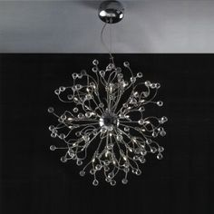 We can hang these chandeliers on the high ceiling homes although there're cute small chandeliers for low ceiling , these modern styles have amazing. Cool Chandeliers, Round Chandelier, Chandelier In Living Room, Chandelier Shades, Chandelier Lighting, Crystal Chandeliers, Ceiling Fixtures, Ceiling Lights, Light Fixtures