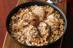 Served piping hot right out of the skillet, this dish with pork chops and golden brown saut