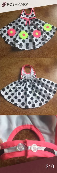 12 month halter dress This 12 month Blueberi boulevard dress is perfect for spring with a two button adjustable halter, elastic back for comfort and crisp bright black white and Floral pattern. Laid flat the measurements are approximately 8 inches wide and 16 lines from shoulder to hem. A cotton polyester blend. Never worn and from a smoke free home. blueberi boulevard Dresses Casual
