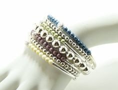 7 strand stretchable stack bracelets with satin blue, pink, silver and ivory in silver. By Simply Uniq Fashion Bracelet. on Etsy, $34.00