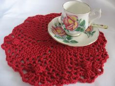 A worsted weight doily to use as a hot pad under your china teapot or other dish.   Finished measurement: 9.5 inches in diameter   Material...