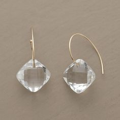 CLEAR CUT EARRINGS -- Diamond-shaped facets illuminate the clarity of rock quartz, each cushion floating on a swirl of 14kt gold wire. Handcrafted in USA exclusively for us. 3/4L.