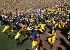 Michigan Wolverines - Classic, unique, an awesome uniform and helmet! There is no recognition issue for the Wolverines! This was voted the best uniform in college football!!