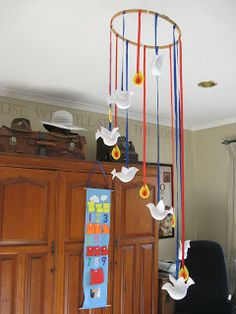 Hang a circle of descending doves and flames to remind us of God's Holy Spirit being poured out. Catholic Crafts, Church Crafts, Day Of Pentecost, Prayer Stations, Circle Crafts, Bible Story Crafts, Church Banners, Sunday School Crafts, Kids Church