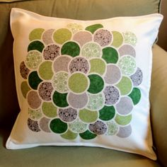 green and gray fabric collage pillow
