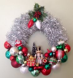 (This entire text is copyrighted) This is a fun, retro wreath done in red, green, white and silver. It features a vintage soldier and good old bulky Christmas light bulbs. It measures approximately 16 diameter with a depth of 5-6. It has a metal wire hook , is lightweight and Christmas 2019, Christmas Door, Christmas Holidays, Christmas Light Bulbs, Modern Christmas, Retro Christmas, Rustic Christmas, Christmas Ornament Wreath, Vintage Christmas Ornaments