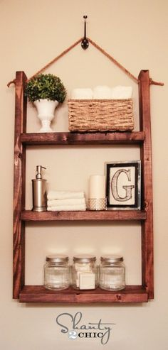 $10 Hanging Bathroom Shelf. Make this adorable shelf with a couple of pine or whitewood boards and some rope. It is perfect for small bathroom walls.