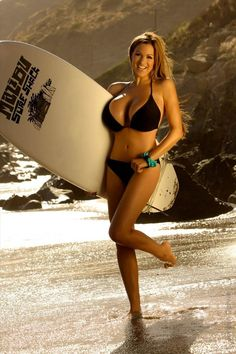 EVERYTHING ABOUT THIS PHOTO IS FAKE!!! She has no surfing muscles, fake boobs that would throw her off balance in a wave, a spray on tan,  in a fake setting, ya those waves are about as big as she can handle thats for sure!