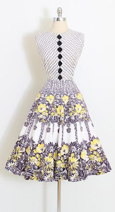 ➳ vintage 1950s dress  * beautiful floral print * diamond shaped cutouts with rhinestone accents * metal back zipper * soft cotton  condition | excellent - normal wash wear  fits like medium  length 44 bodice length 17 bust 38 waist 28  ➳ shop http://www.etsy.com/shop/millstreetvintage?ref=si_shop  ➳ shop policies http://www.etsy.com/shop/millstreetvintage/policy  twitter | MillStVintage facebook | millstreetvintage instagram | millstreetvint...