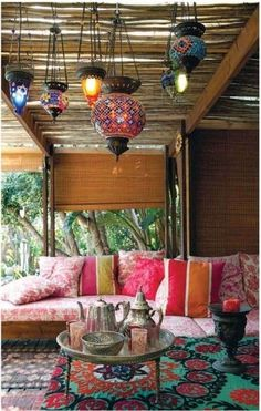Central Asian theme for a porch/patio. Tea set - check; lanterns - check; suzani pillows - check. Just need the couches and a larger suzani piece!