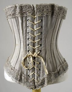 Corset  Date:1895–1905    Culture:     American (probably)      Medium:(a) cotton; (b) lace         Dimensions: Length at CB: 11 in. (27.9 cm)   the metropolitan museum of art