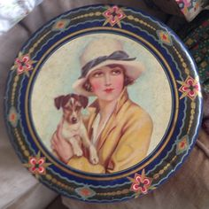 Old English Decor Biscuits Tin, Firm unknown but seldom beautifull Graphic of a proud doggie with his Female Chef, in my possesion and for sale