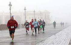 Jen Marra / Runners and walkers participate in a Pi Day 5K and 314-yard dash Saturday, March 14 hosted by the Ocean City Education Association. Runners take their mark at the intersection of Sixth Street and Asbury Avenue and finish in front of Gillian's Wonderland Pier on the boardwalk. Brandon Hadtke, 18, of Ocean City is the first to finish the race and gets Pi-ed as he crosses the finish line. Primary school students have fun racing a rainy 314-yard dash on the boardwalk before heading in to the Ocean City Civic Center to refuel with snacks and warm up with math-related activities.
