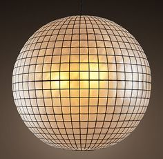 """RH's Capiz Shell Pendant 36"""":A go-to in fashionable 1960s interiors, the Capiz Shell Pendant still offers mood-setting light through its luminescent shell panes. Each has been cut from an individual natural shell, and then framed in a sturdy metal grid to form a pleasing globe shape."""
