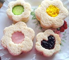 Tea Sandwich ideas: Cut flower or heart shapes from bread using cookie cutters.  Fill with egg salad, chicken salad, pb, etc.