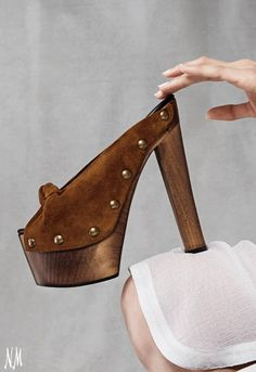 Crazy about the new bohemian, '70s-inspired spring trend. This Giuseppe Zanotti Brown Suede-Knot Wooden Slide Clog is the perfect shoe to pair with flare pants and boho blouses. #NMshoelove