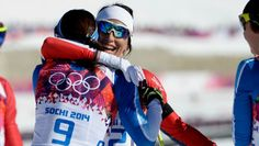 Women's Skiathlon Marit Bjorgen (NOR) hugs a competitor after winning the women's skiathlon event during the Sochi 2014 Olympic Winter Games at Laura Cross-Country Ski and Biathlon Center.