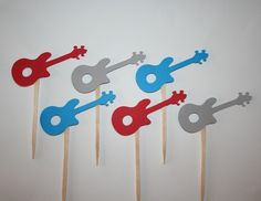 Guitar Cupcake Toppers. $8.50, via Etsy.