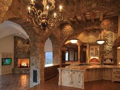 love the arched entrances and the stovetop facing out on the island