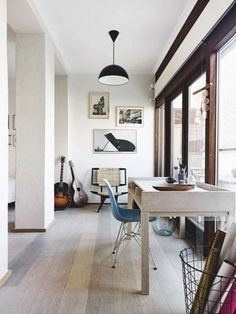 Lovely pale floorboards and white walls- scandinavian retreat.