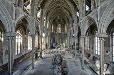 An abandoned church in Pennsylvania is filled with construction detritus below the graceful arches.
