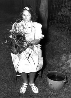 Lottie Stamfer, instructor of basket weaving at Cherokee Indian School. Photographed at Sevier County Tennessee, 1948. Dept. of Conservation Photograph Collection.