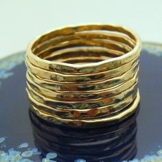 Etsy の Hammered Gold Ring 7 Band Set by Forkwhisperer