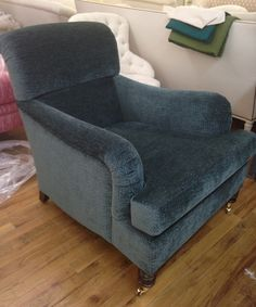 The club chair in a soft and cozy chenille by Schumacher