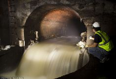 Hold your nose: Urban explorer Steve Duncan surveys a sewer outfall in Wallabout, one of the oldest areas of Brooklyn, New York, as he sets ...