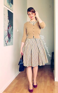 Polka dots + full pleated skirt + cardigan = adorable.