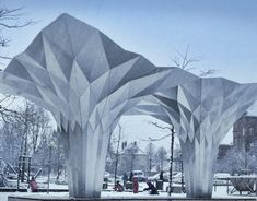 The project is an Origami inspired pavilion folded out of rigid aluminium boards. It is fully self supporting and does not require a sub structure. The design is parametric and uses various optimization algorithms.