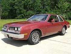 1978 Pontiac Sunbird My first car white with red vinyl top