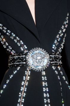 Rhinestones -Versace 2013 - Cool! Wonder if I could make a belt using old coins?! #fashion #accessory #DIY