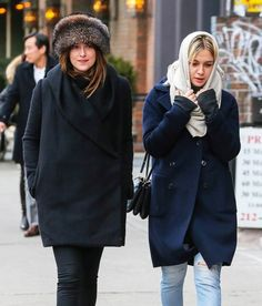 Dakota Johnson Photos Photos - 'Fifty Shades Of Grey' actress Dakota Johnson is spotted out for a stroll with a friend in New York City, New York on February 16, 2015. Dakota is enjoying NYC after attending the SNL 40th Anniversary Gala last night. - Dakota Johnson Out With A Friend In NYC