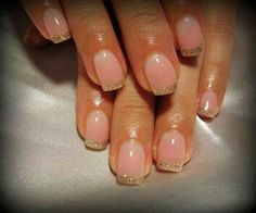 Nude color nails with gold tips