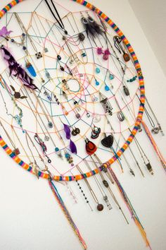 wow... kind of busy with all the jewelry, but making a huge dream catcher like this seems like a fun project :)