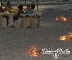 Beautiful night wedding on the Beach in front of Henderson Park Inn