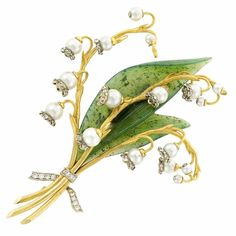 Gold, Carved Nephrite, Cultured Pearl and Diamond Lily of the Valley Clip-Brooch, Zadora 18 kt., 13 pearls ap. 5.6 to 4.2 mm., signed Zadora, ap. 14.5 dwts.