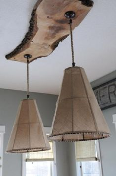 burlap lights hung on salvage piece of raw wood