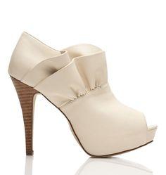 white shoe with ruffles