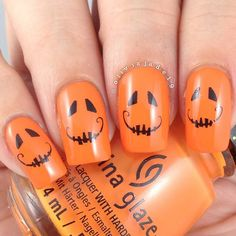 @Oliviajade19 did easy Jack-o'-lantern nails by using water decals from the Born Pretty Store over orange polish.