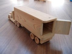 Jeffery the refrigerator wooden toy truck – a semi-trailer toy made of wood - Spielzeug Wooden Toy Trucks, Wooden Car, Wooden Blocks, Woodworking Toys, Woodworking Projects, Toy Garage, Kids Wood, Wood Toys, Made Of Wood