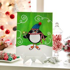 Paint a whimsical winter penguin for your holiday decor.