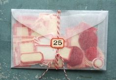 gotta love a glassine envelope + bakers twine (especially when it's full of vintage labels!)