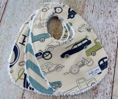 Such a cute Retro Rides bib set for all the little baby boys out there. This super trendy Retro Rides bib set features a car and motorcycle bib, a blue chevron bib and an alphabet print bib. This baby