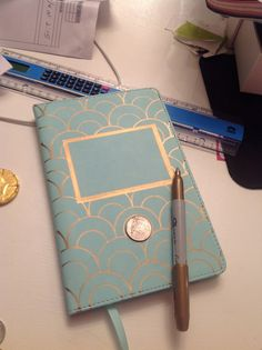 DIY decorated notebook with a gold Sharpie
