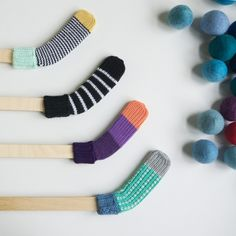 Hockey sticks wrapped by a knit cover - Des Enfantillages or socks.. Much better for inside..