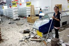 Workers clean the floor next to empty shelves and refrigerators in a supermarket after it was looted in San Cristobal, Venezuela May 17, 2017. REUTERS/Carlos Eduardo Ramirez #venezuela #reutersphotos #reuters #looting #sancristobal